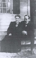Eben Alexander sitting with his wife, Marion Howard-Smith Alexander, on the front steps of their Chapel Hill house, c. 1900. | Southern Historical Collection, Wilson Library
