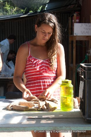 Robyn Le Blanc working with pottery