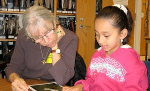 Sara Mack reads with a student.