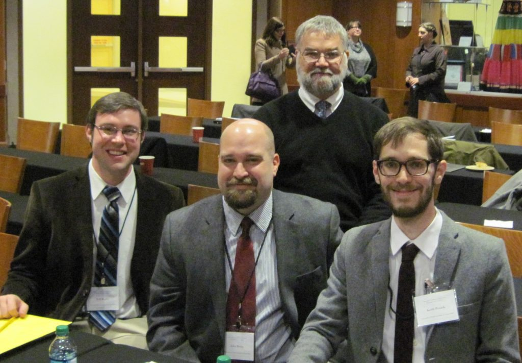 Will Begley, John Beeby, and Keith Penich (front, l-r), presented their work from Bob Babcock's Latin paleography class at the Texts and Contexts conference. Prof. Babcock (back) chaired the students' discussion of the origins of eleventh-century manuscripts from Gembloux, a Belgian abbey.