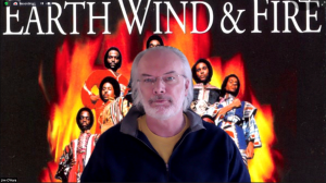 Jim O'Hara with the Band Earth Wind & Fire behind him.